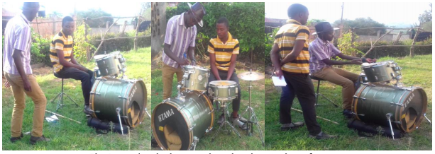 Young man learning to play the drums