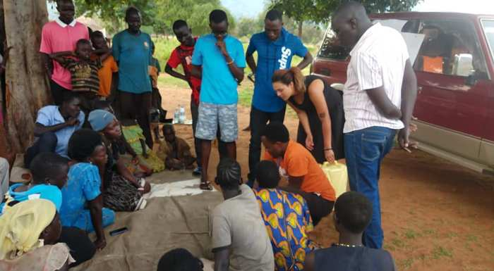 Volunteer group teach Ugandan locals how to make liquid soap