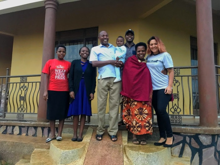 Volunteer with host family in Uganda