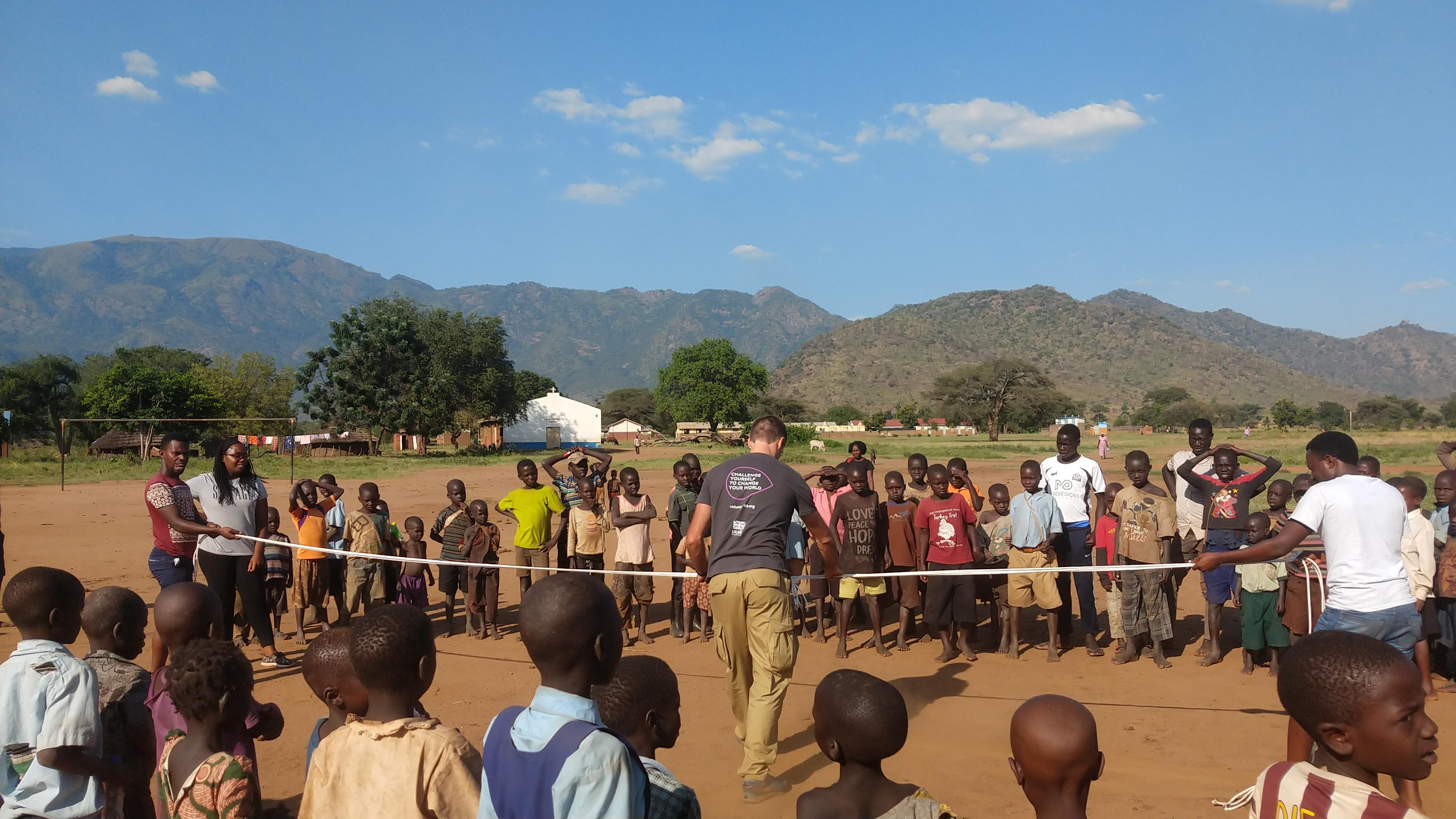 Volunteers play game with local children in North Uganda