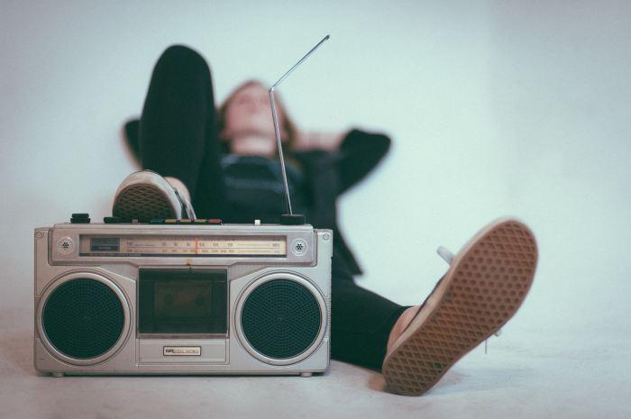 Women Listening to Music with speaker