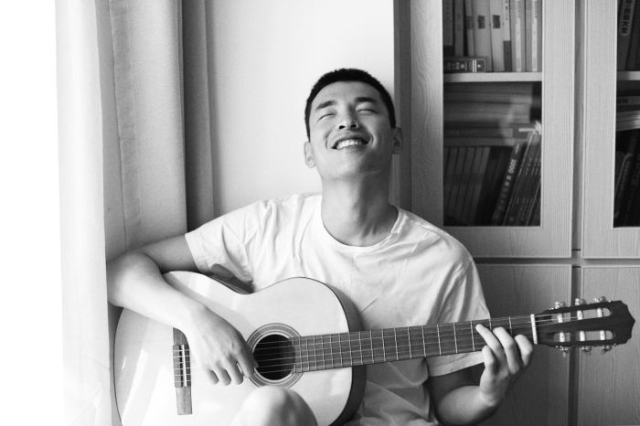 happy man playing guitar