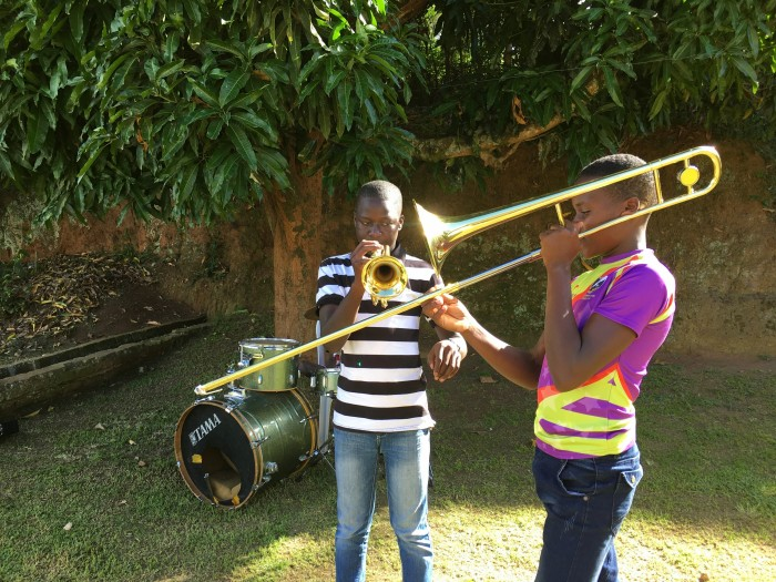two boys play instruments